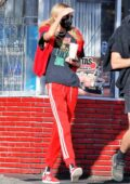 Stella Maxwell dons red tracksuit with matching sneakers while out for some coffee with a friend in Los Angeles