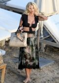 Victoria Silvstedt dresses in a black top and floral print skirt while enjoying a day at the beach in St Barth, France