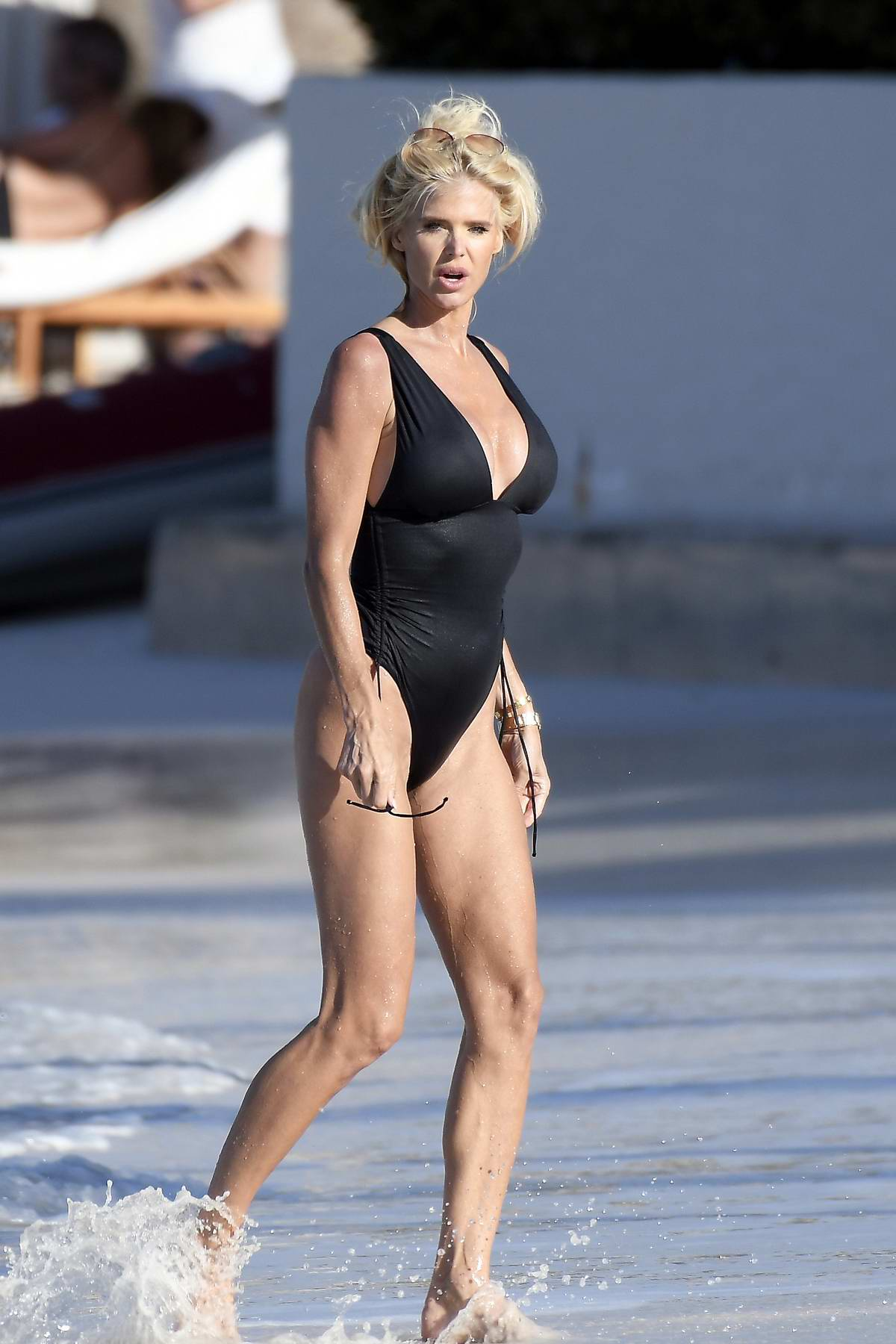 Victoria Silvstedt shows off her amazing figure in a black swimsuit while enjoying the sun in St Barts, France
