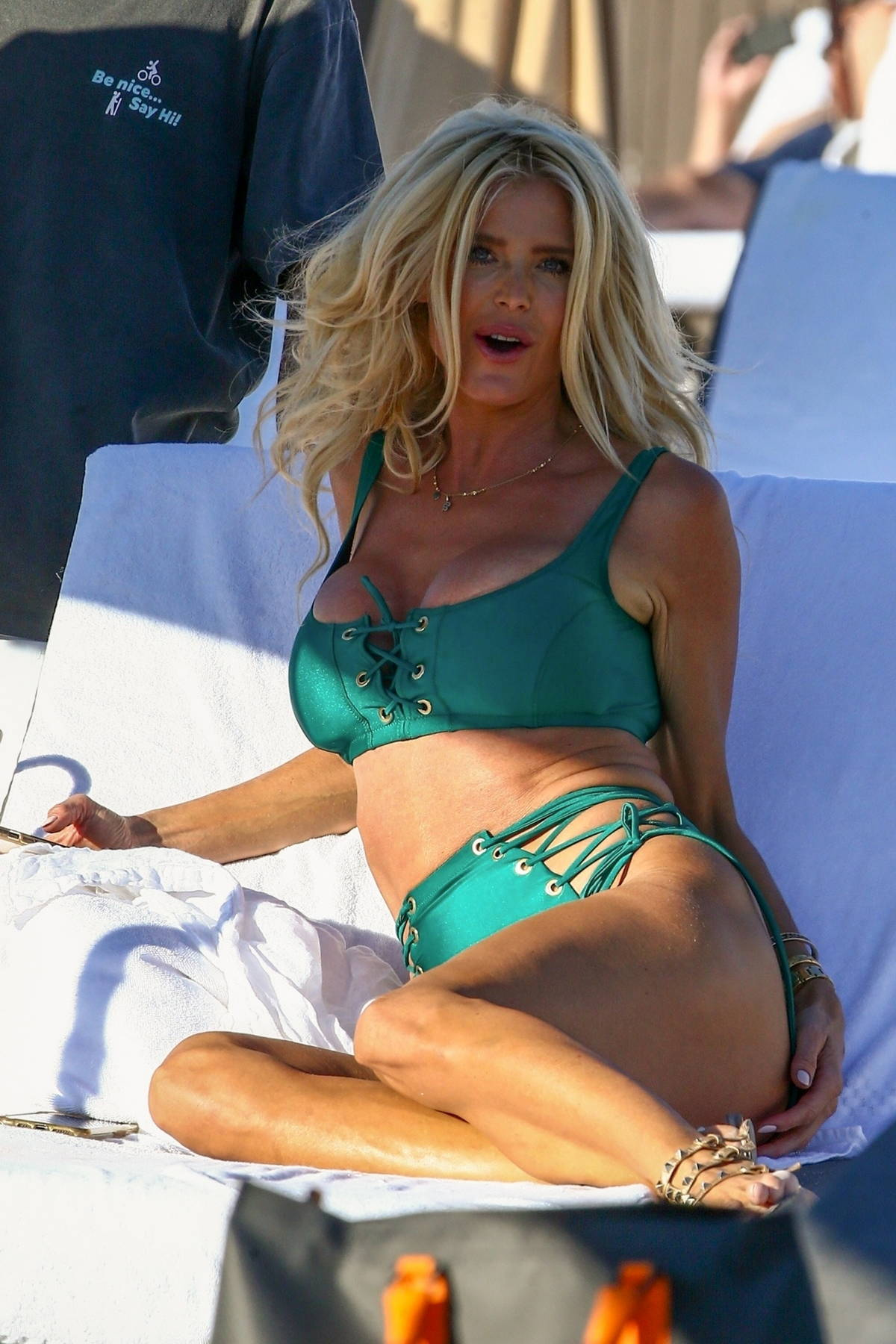 Victoria Silvstedt shows off her tan figure in a green bikini while relaxing on the beach in Miami Beach, Florida