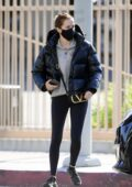 Zoey Deutch sports a black puffer jacket and leggings while running errands on a chilly day in Los Angeles