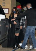 Addison Rae and Bryce Hall hold hands as they leave after dinner at Nobu in Malibu, California