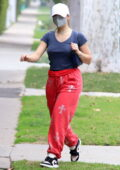 Addison Rae wears red sweatpants and dark grey top for a private Pilates session in West Hollywood, California