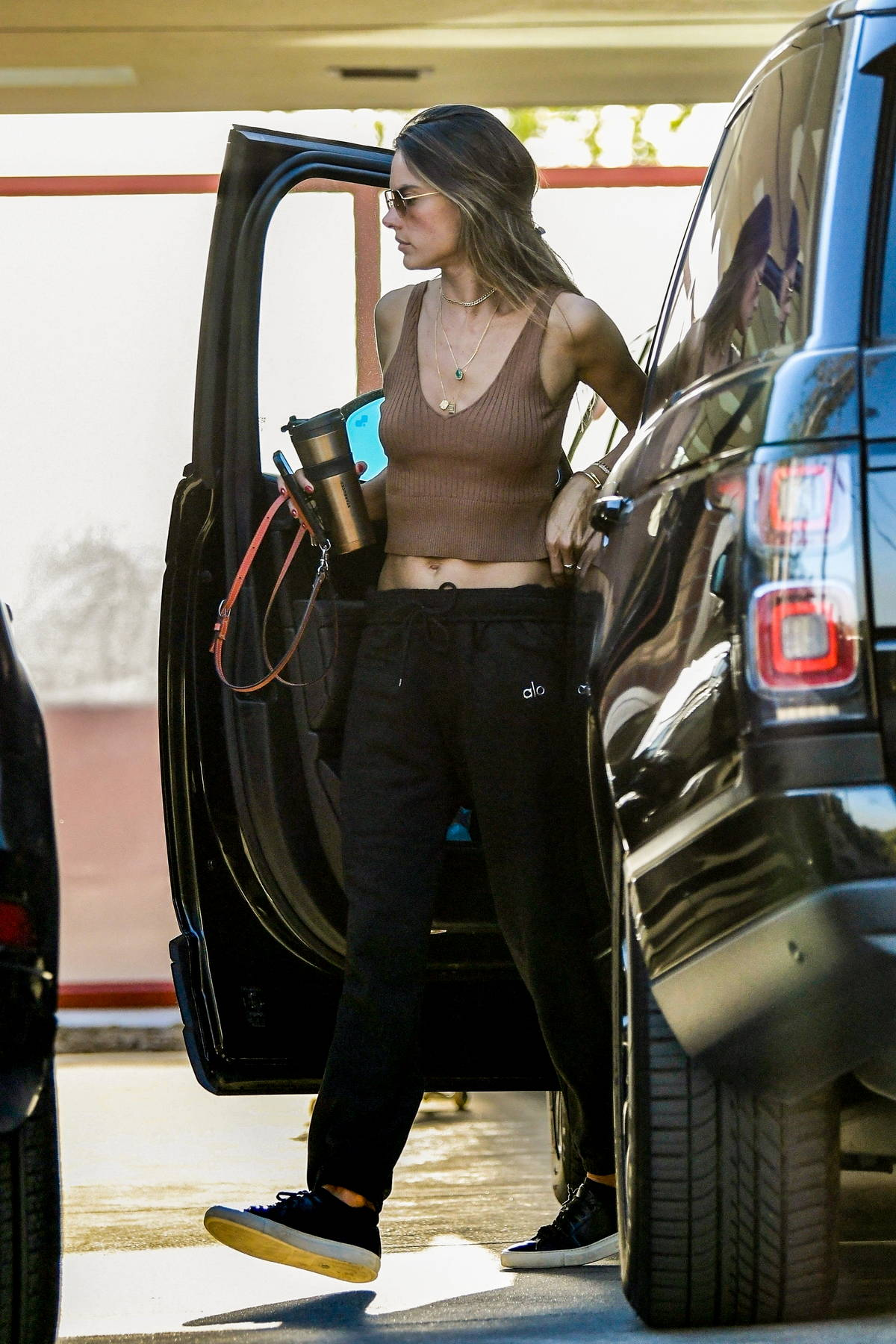 Alessandra Ambrosio displays her svelte figure in a cropped tank top while visiting a friend in Bel Air, California