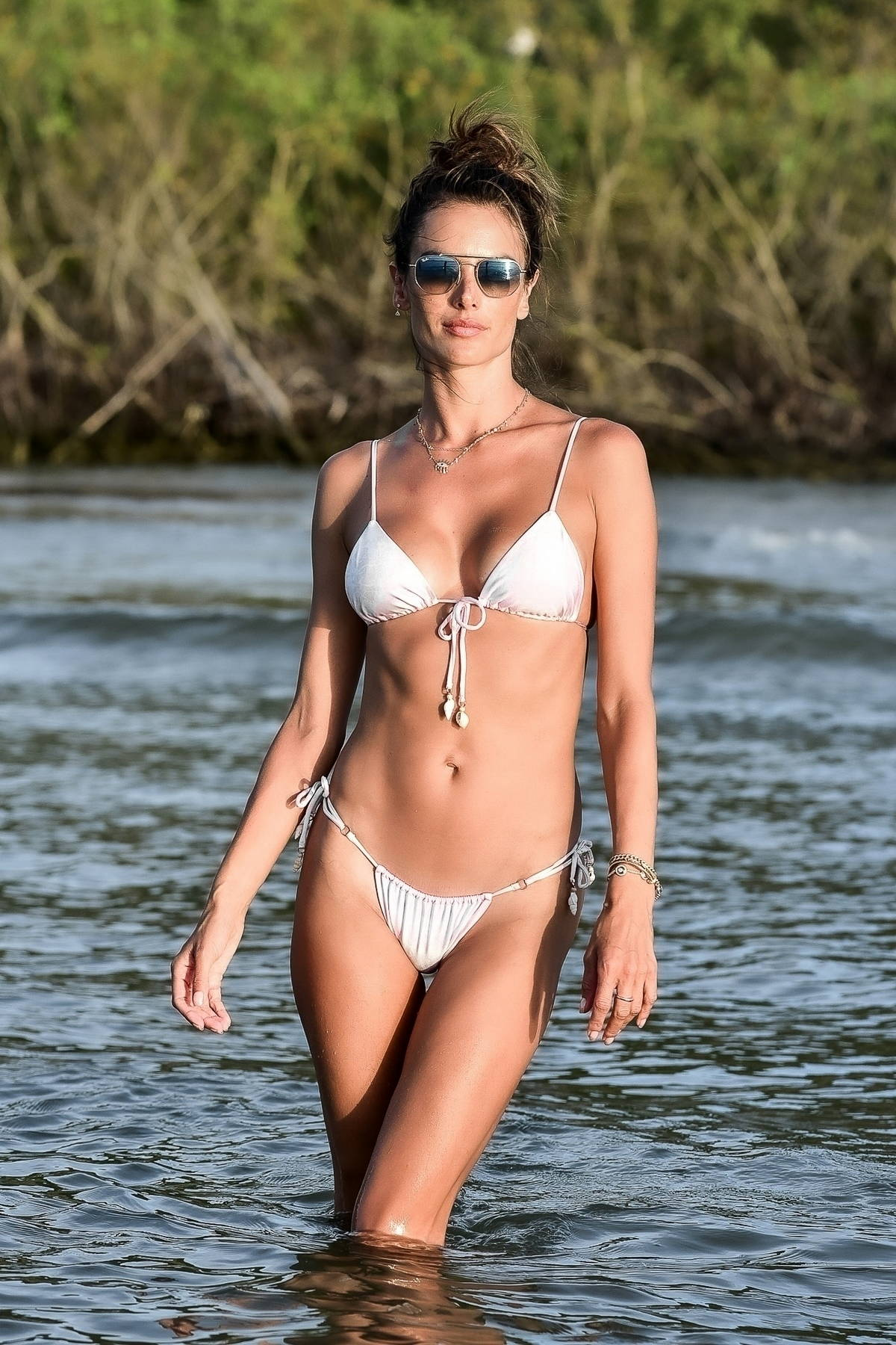 Alessandra Ambrosio looks flawless while posing in a soft pink bikini at the beach in Florianopolis, Brazil