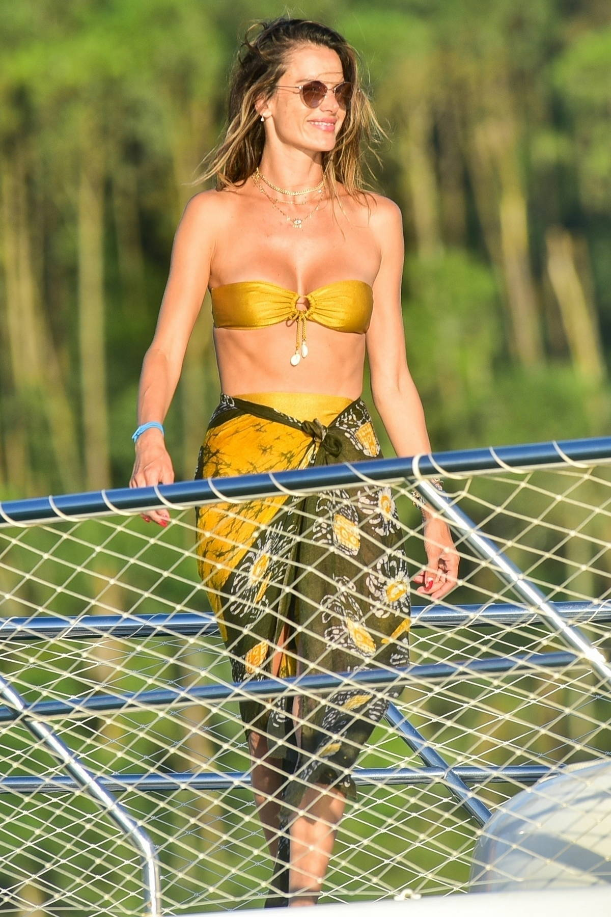 Alessandra Ambrosio looks sensational in a gold bikini while enjoying a day on a luxury yacht with friends in Florianopolis, Brazil