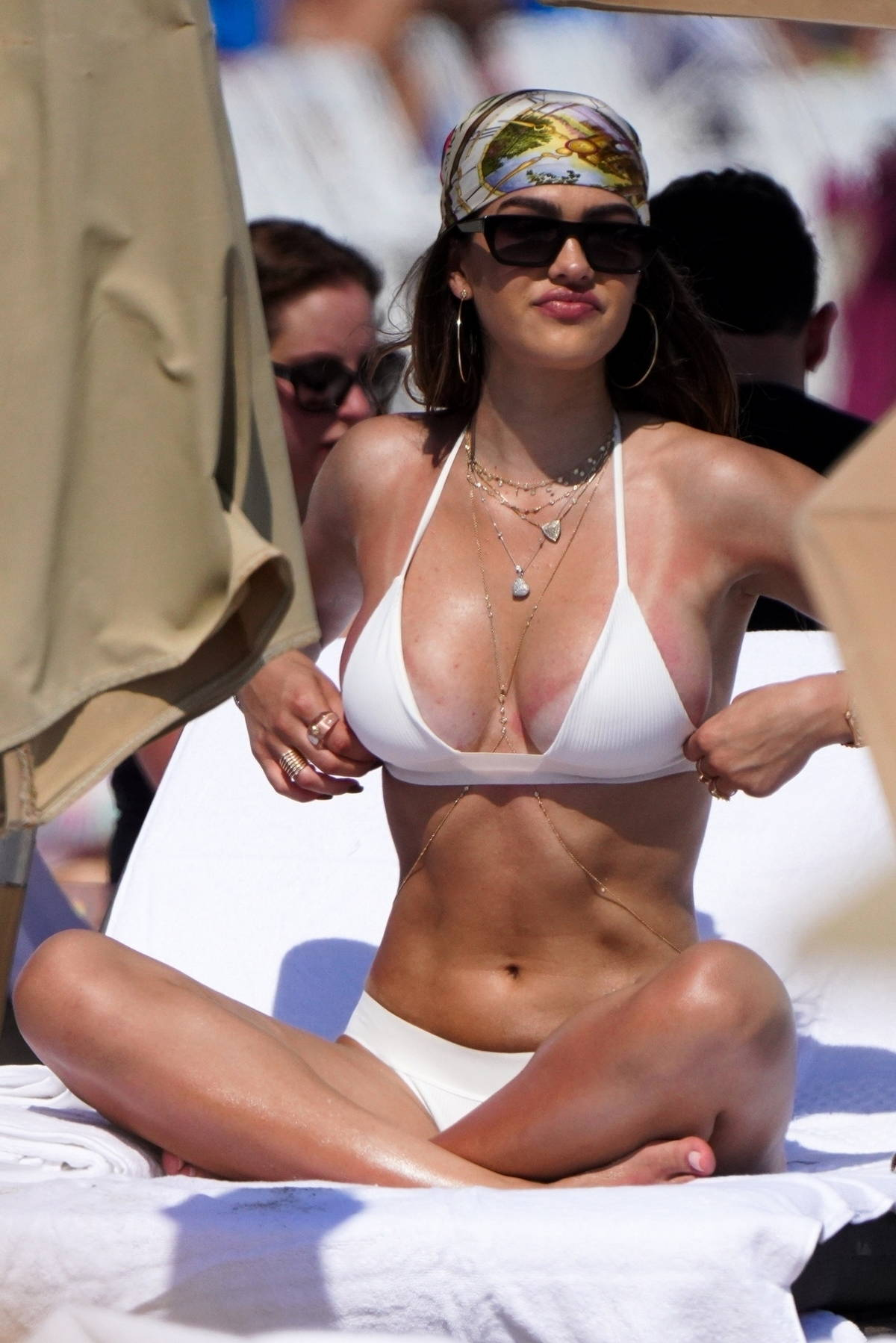 Amelia Hamlin soaks up the sun in a white bikini while enjoying the beach with Scott Disick on Valentine's Day in Miami, Florida