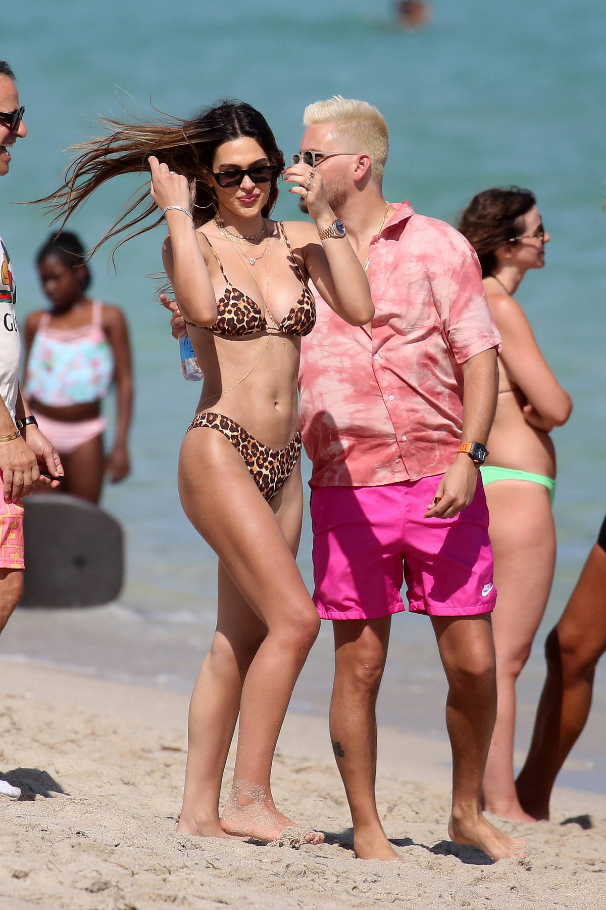 Amelia Hamlin stuns in an animal print bikini as she hits the pool with Scott Disick in Miami, Florida