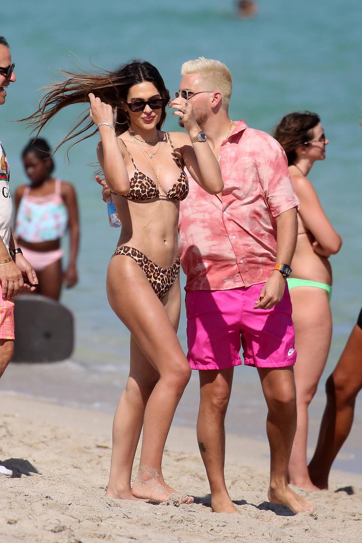 Amelia Hamlin stuns in an animal print bikini as she hits the pool with Scott Disick in Miami, Florida