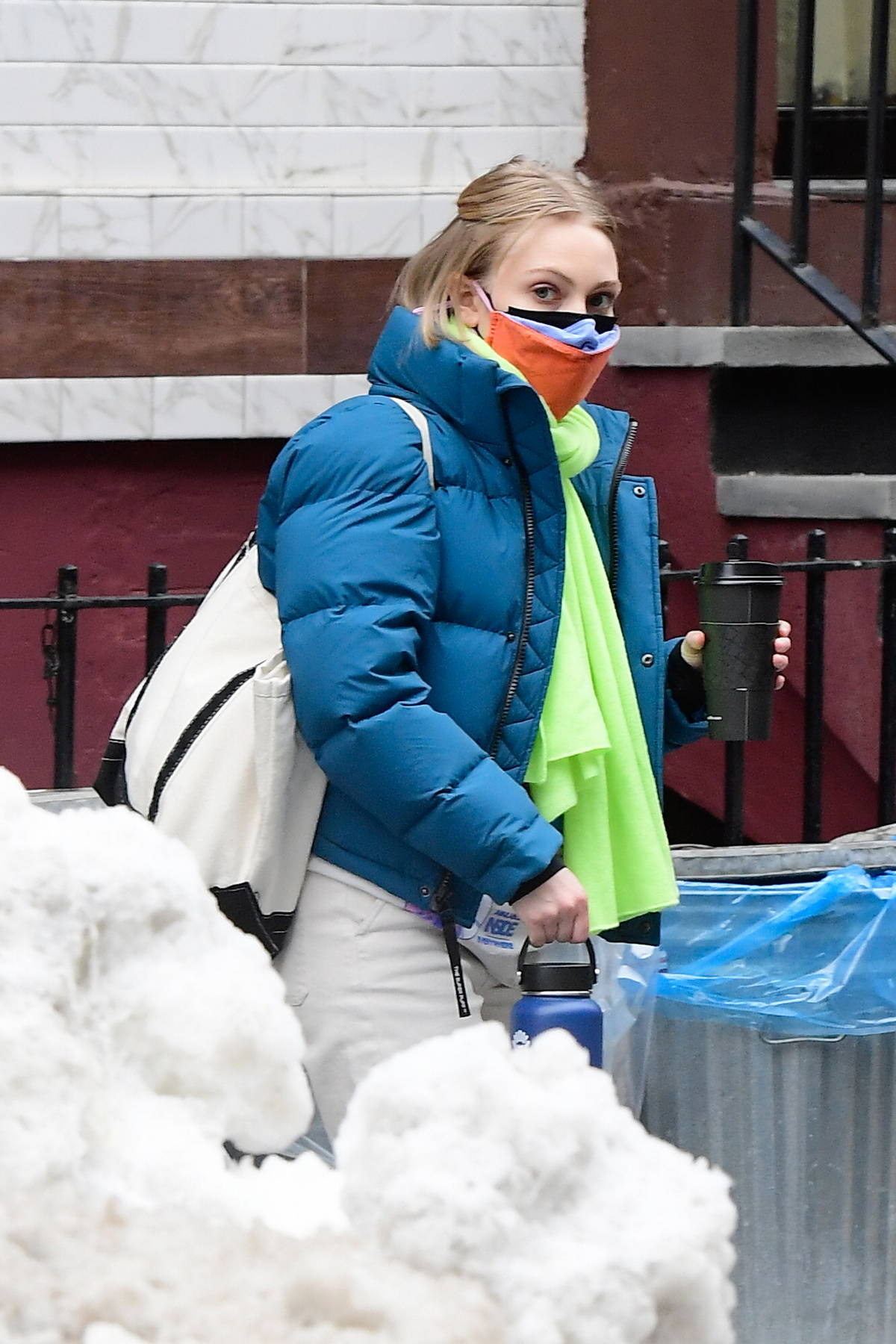 AnnaSophia Robb seen wearing three face masks as she arrives on the set of 'Dr Death' in New York City