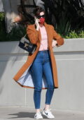 Anne Hathaway keeps it casual chic in a burnt orange coat as she heads to a meeting in Santa Monica, California