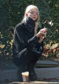 Anya Taylor-Joy grabs a smoke and a coffee on the sidewalk as she stepped out in Los Angeles