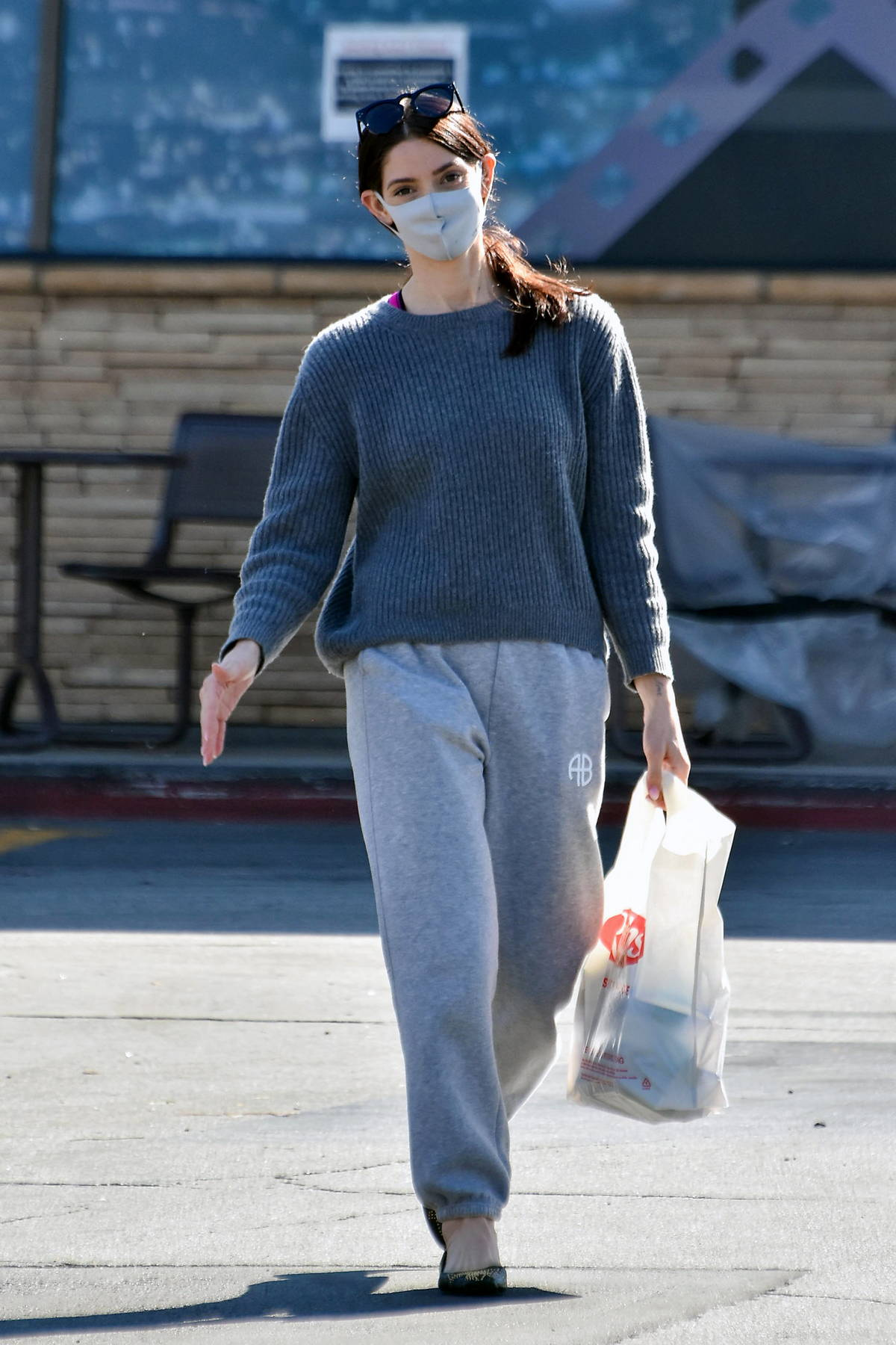 Ashley Greene keeps cozy in a grey sweater and sweatpants during a quick grocery run in Los Angeles