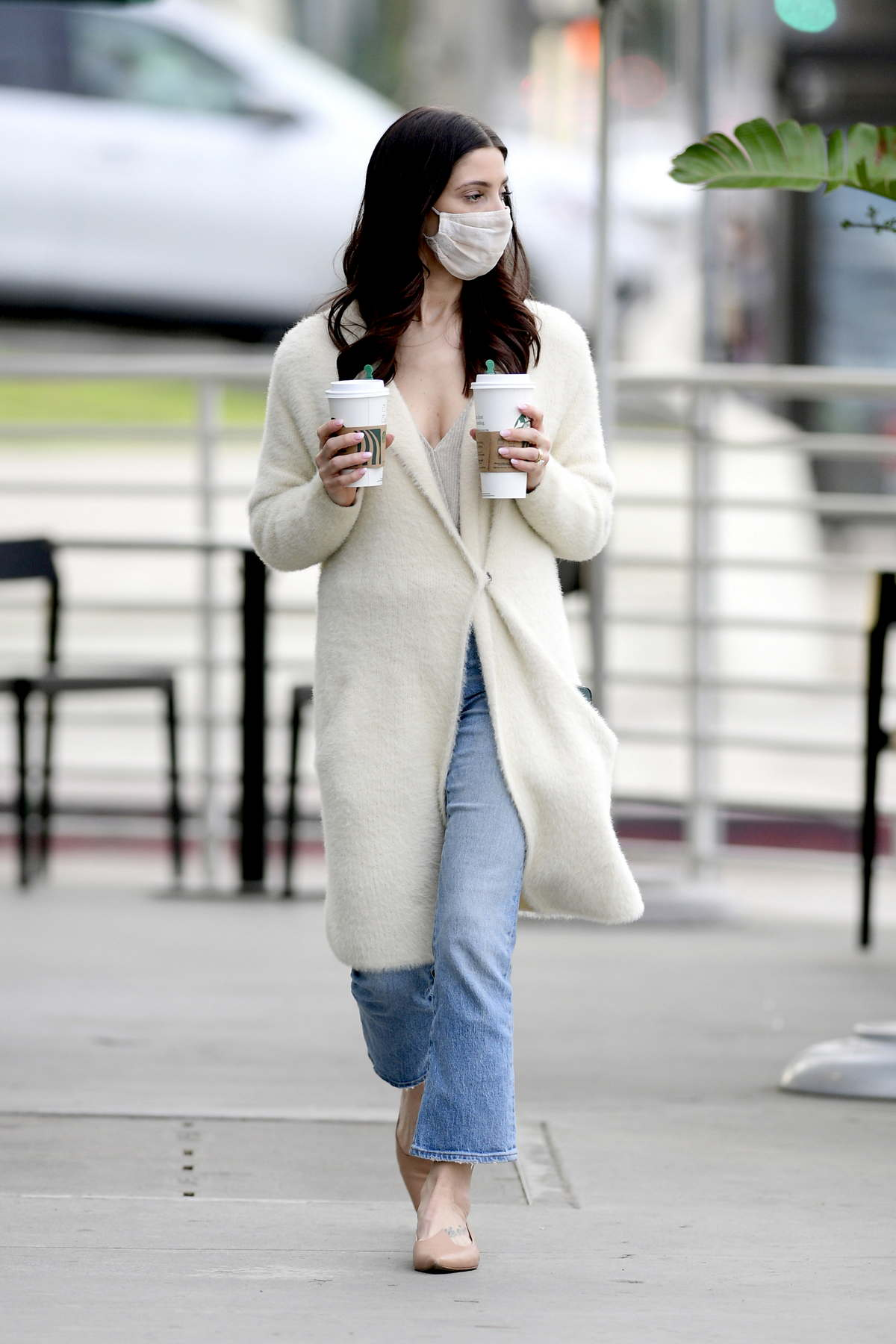 Ashley Greene looks chic in a white coat with blue denim while making a coffee run in Los Angeles