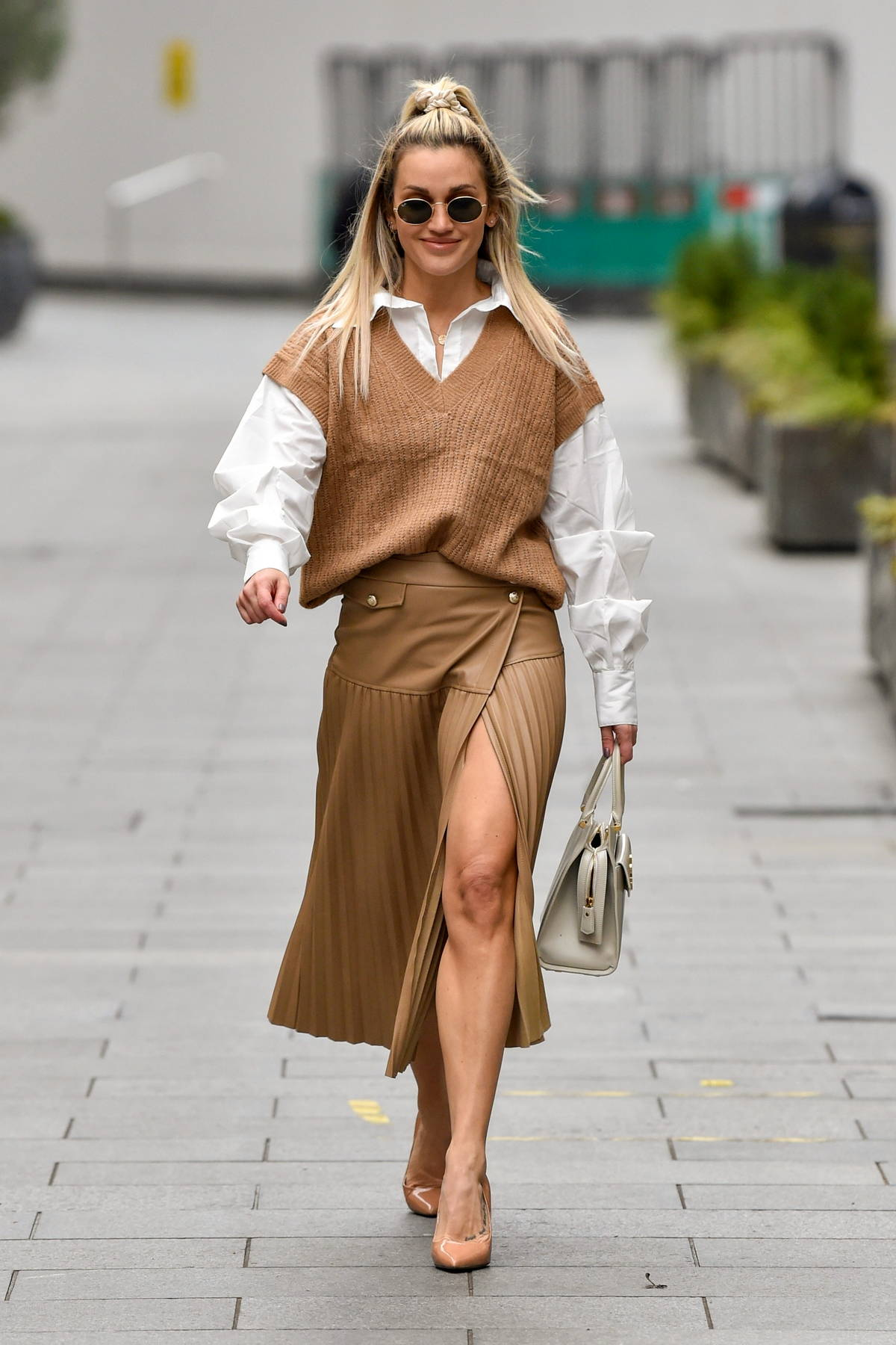 Ashley Roberts keeps it stylish with a brown slit skirt with matching sweater as she leaves Global Radio Studios in London, UK