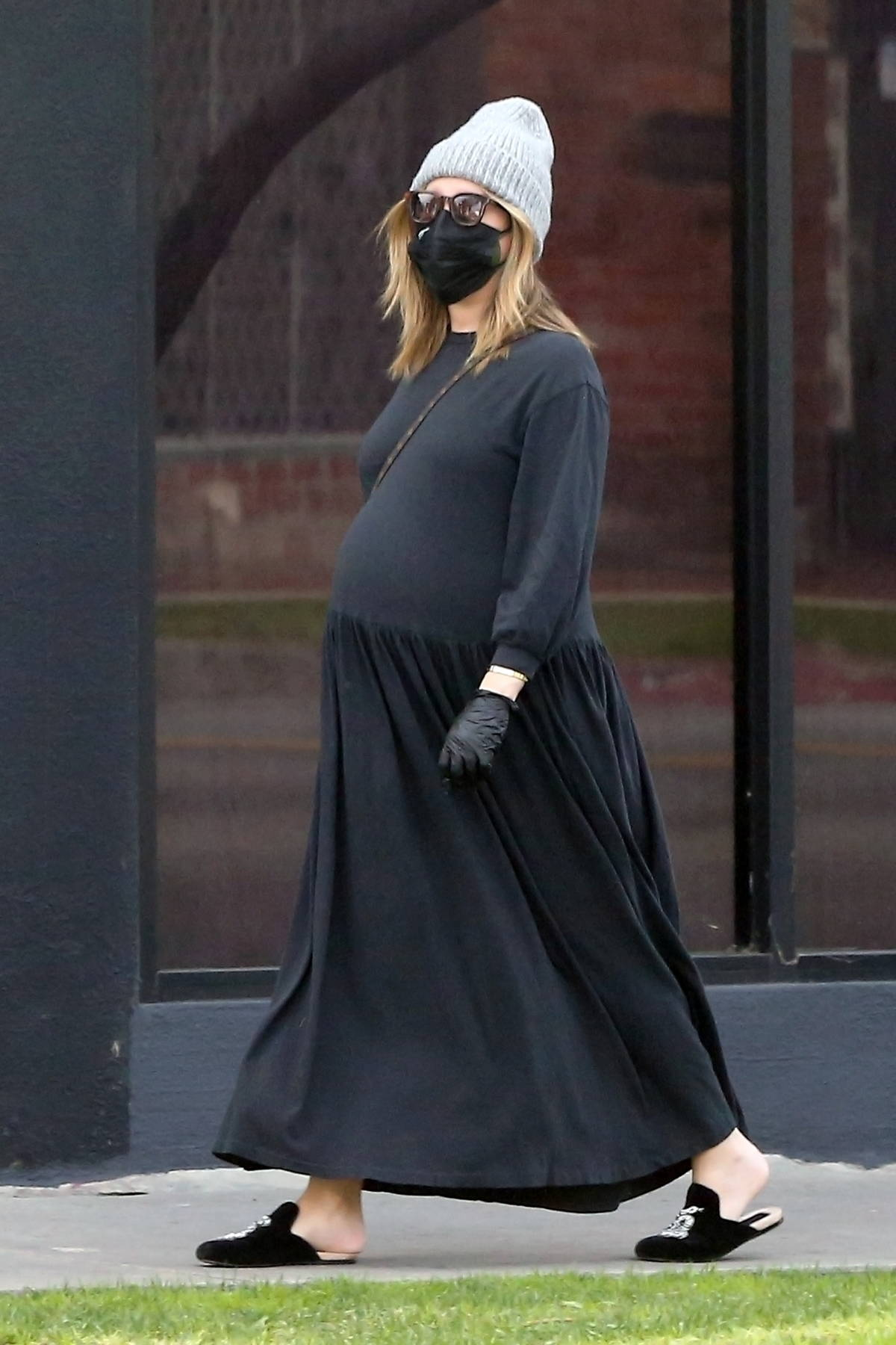 Ashley Tisdale shows her baby bump as she steps out in all-black for some shopping in West Hollywood, California
