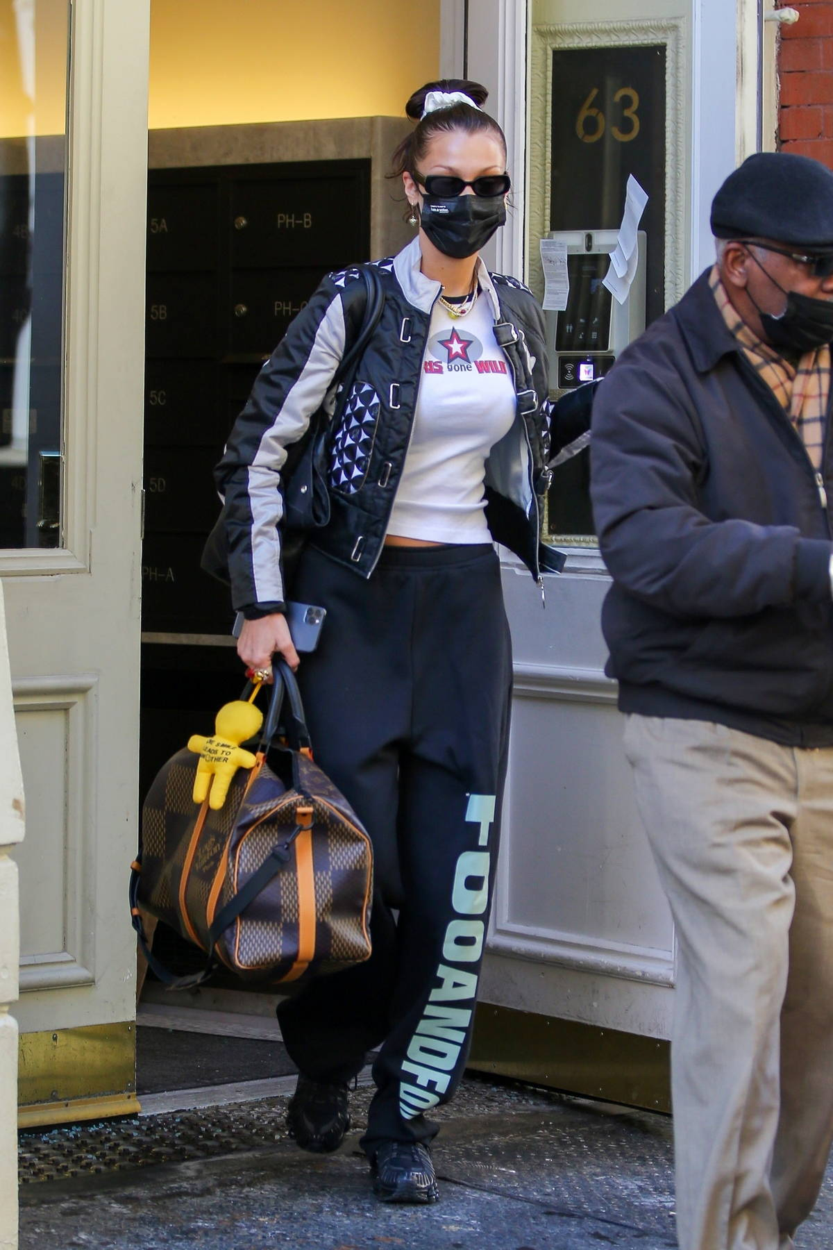 Bella Hadid keeps it trendy as she leaves her apartment with her Louis Vuitton luggage in New York City