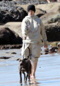 Billie Eilish goes incognito in her oversized clothes while on the beach with her brother Finneas O'Connell in Malibu, California