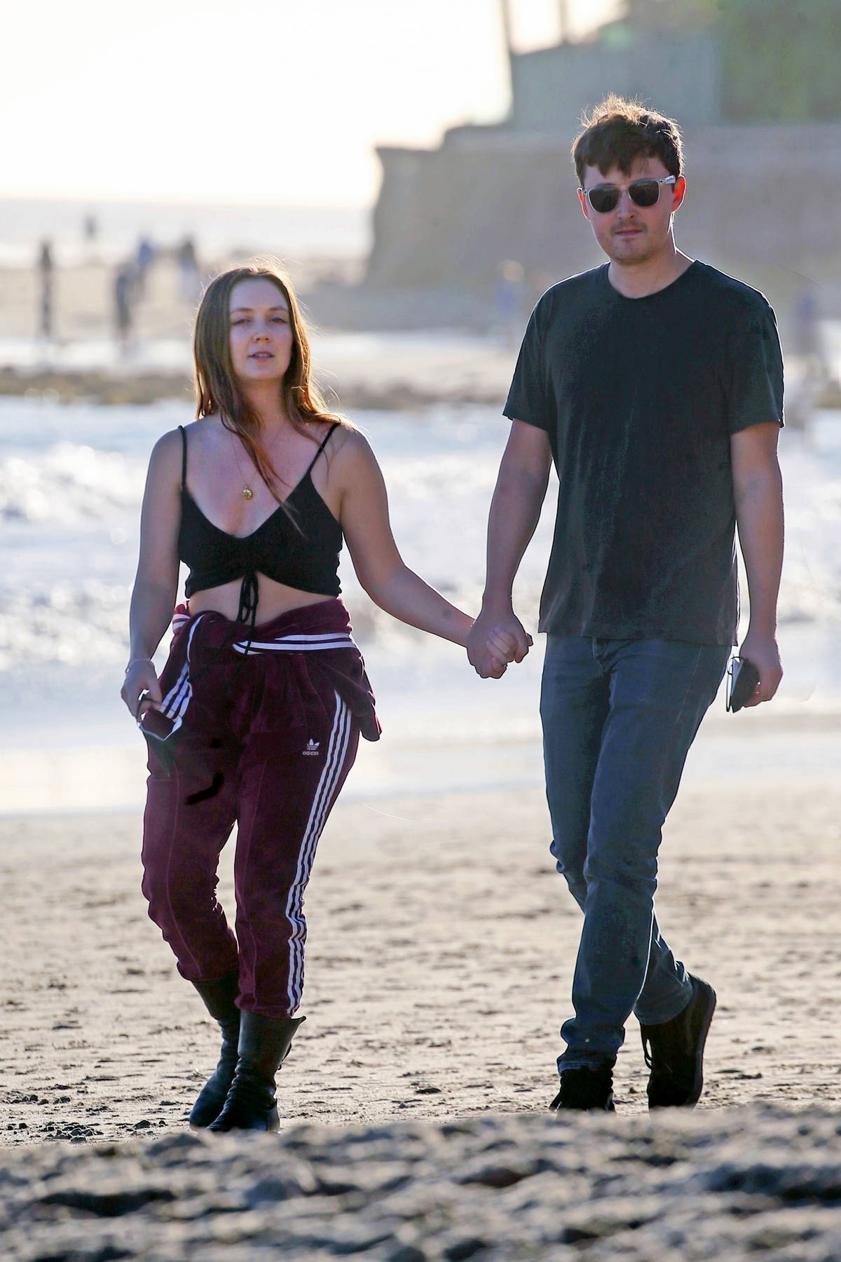 Billie Lourd flashes her diamond engagement ring on the beach with her fiancé Austen Rydell in Santa Barbara, California
