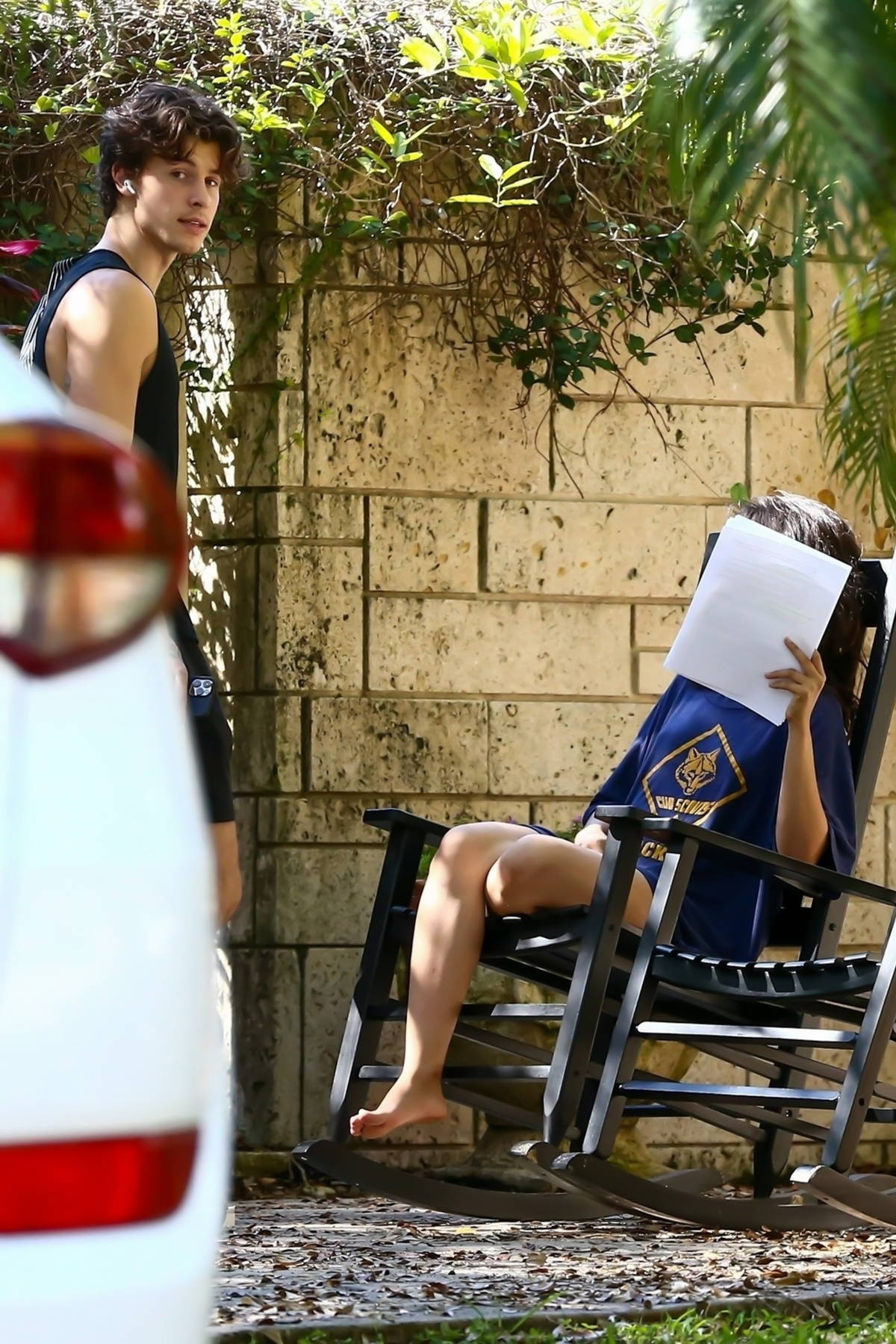 Camila Cabello seen reading on a rocking chair while Shawn Mendes goes for a walk around the neighborhood in Miami, Florida