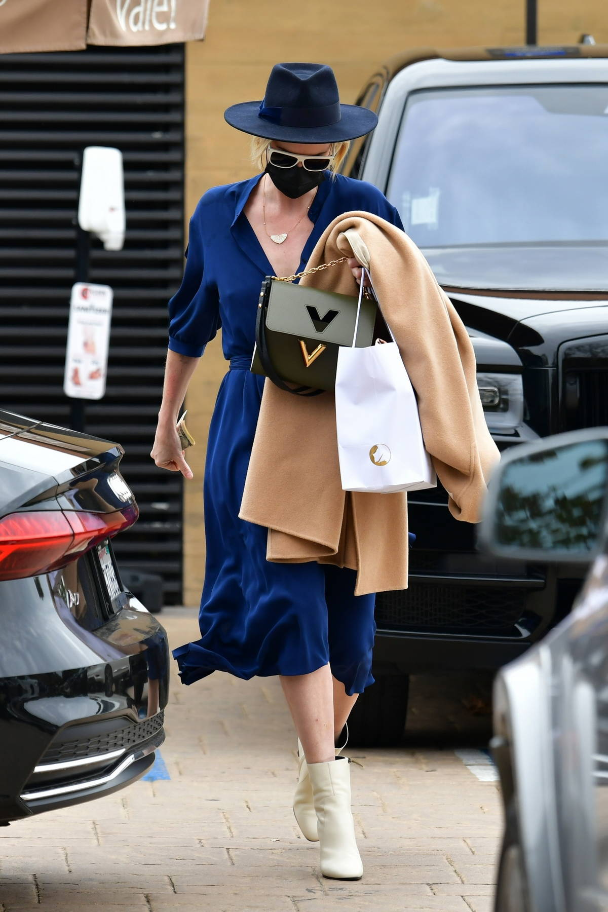 Charlize Theron looks stylish in a blue dress during a family lunch outing at Nobu in Malibu, California