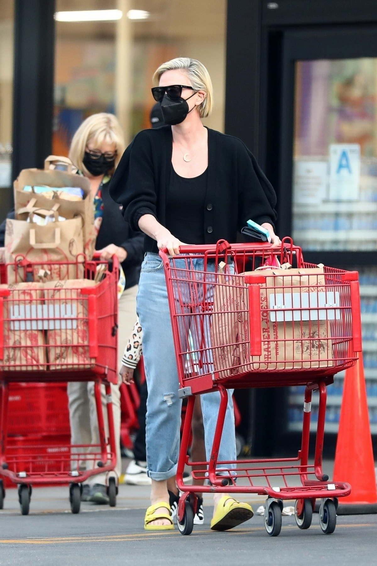 Charlize Theron makes a grocery run with her mother and daughter at Trader Joe's in Los Angeles