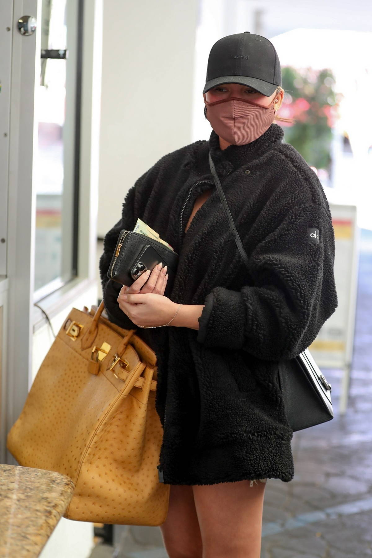 Chrissy Teigein waits for her car at the valet after a doctor's visit in Beverly Hills, California
