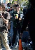 Dakota Johnson seen wearing a face shield on the set of 'Am I OK' in Los Angeles