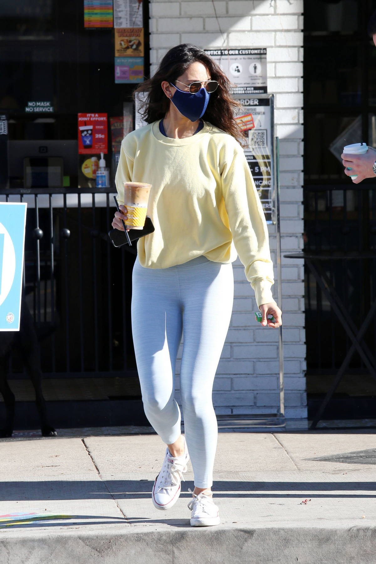 Eiza Gonzalez keeps it sporty with a sweatshirt and leggings during a coffee run at Alfred's coffee in Los Angeles