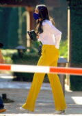 Eiza Gonzalez looks striking in bright yellow trousers with a white shirt as she leaves a business meeting in Los Angeles