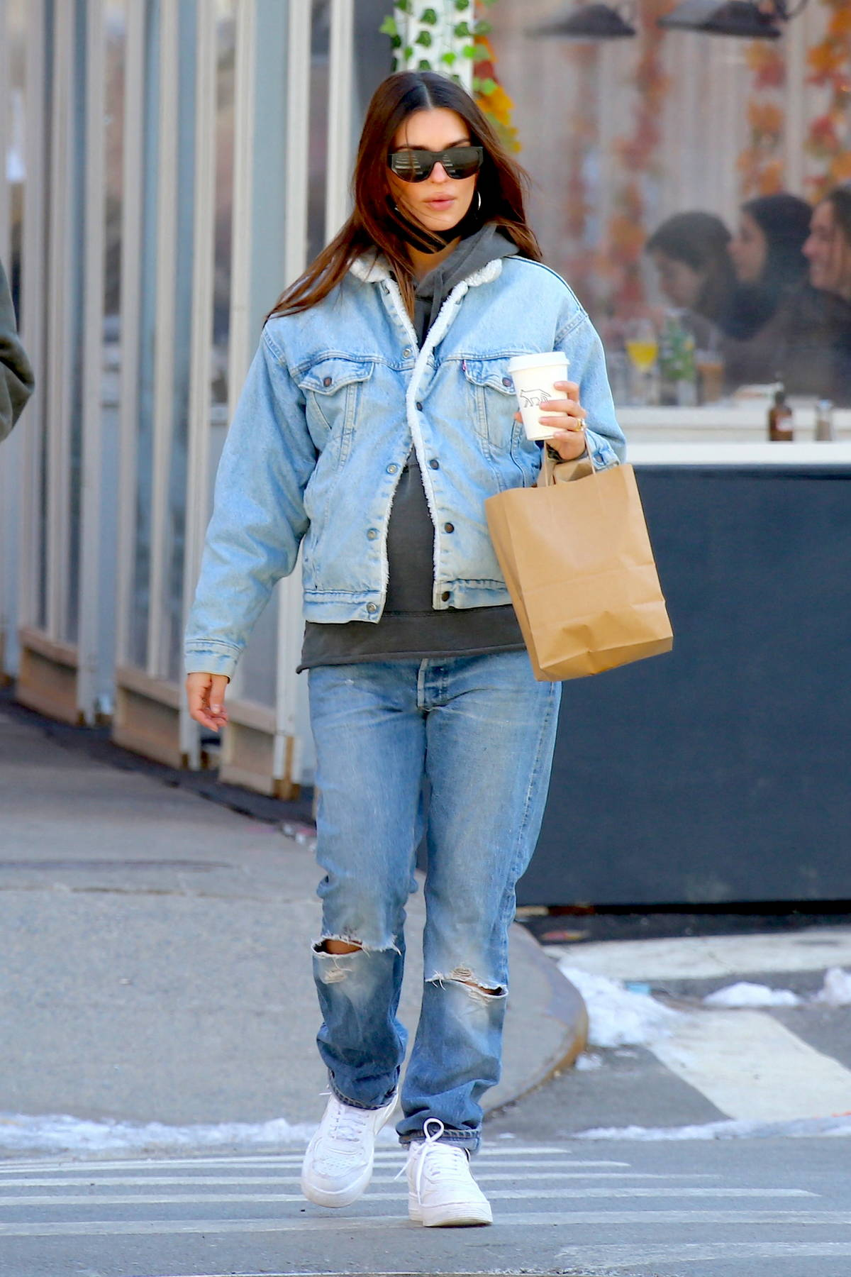 Emily Ratajkowski dons double denim as she steps out for a stroll with her husband in New York City