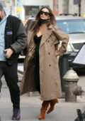 Emily Ratajkowski looks stylish in a camel-colored trench coat over a black dress as she steps out for a stroll in New York City