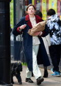 Emma Corrin keeps it casual yet stylish as she steps out for a walk with a friend in London, UK