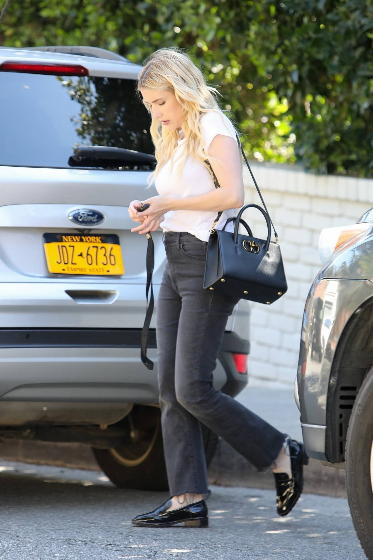 Emma Roberts keeps it casual as she heads to a photoshoot in Los Angeles