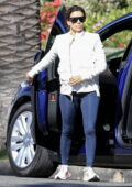 Eva Longoria seen wearing a white jacket and blue leggings while out in Beverly Hills, California