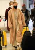 Florence Pugh looks cozy in a full-length teddy coat as she arrives for a flight out of LAX in Los Angeles