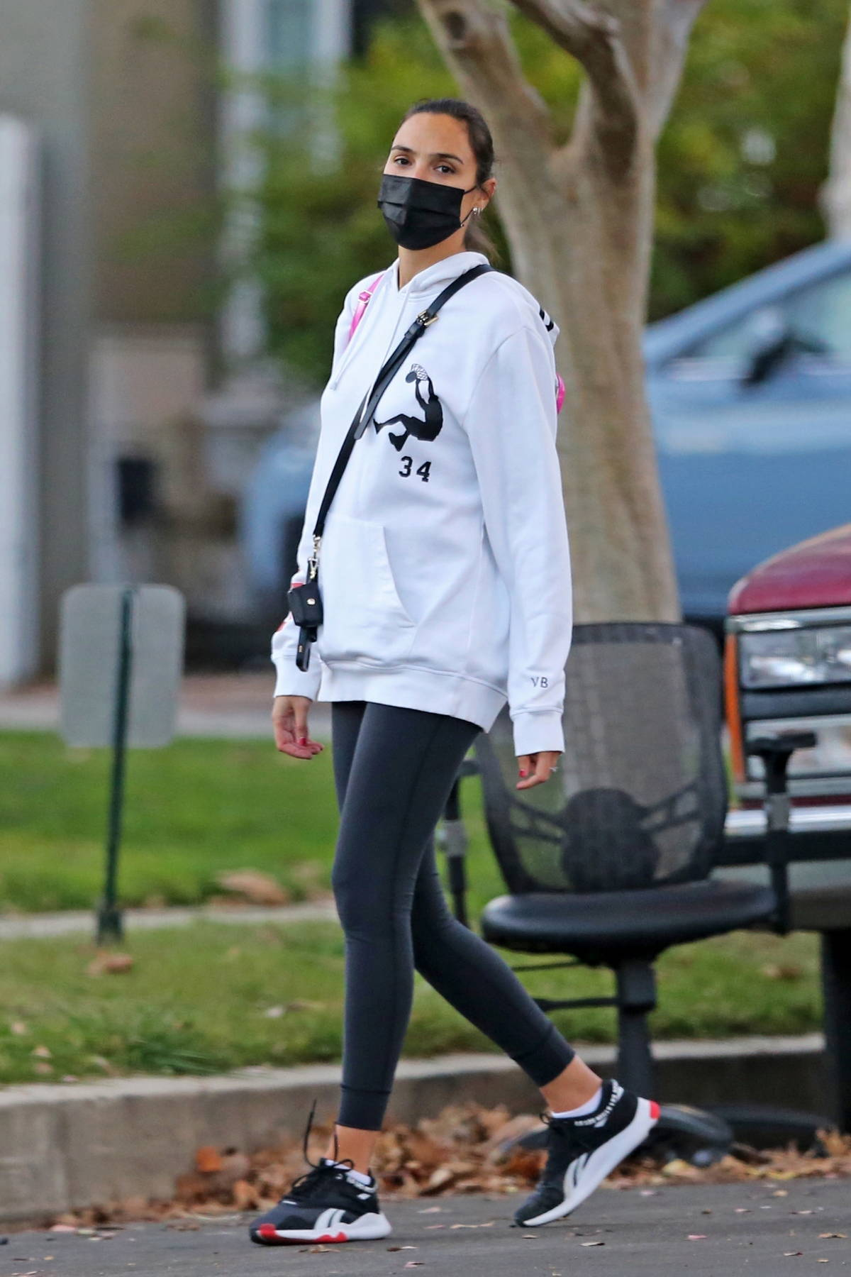 Gal Gadot keeps it sporty with a Reebok hoodie and leggings while out for a stroll with her daughter in Studio City, California