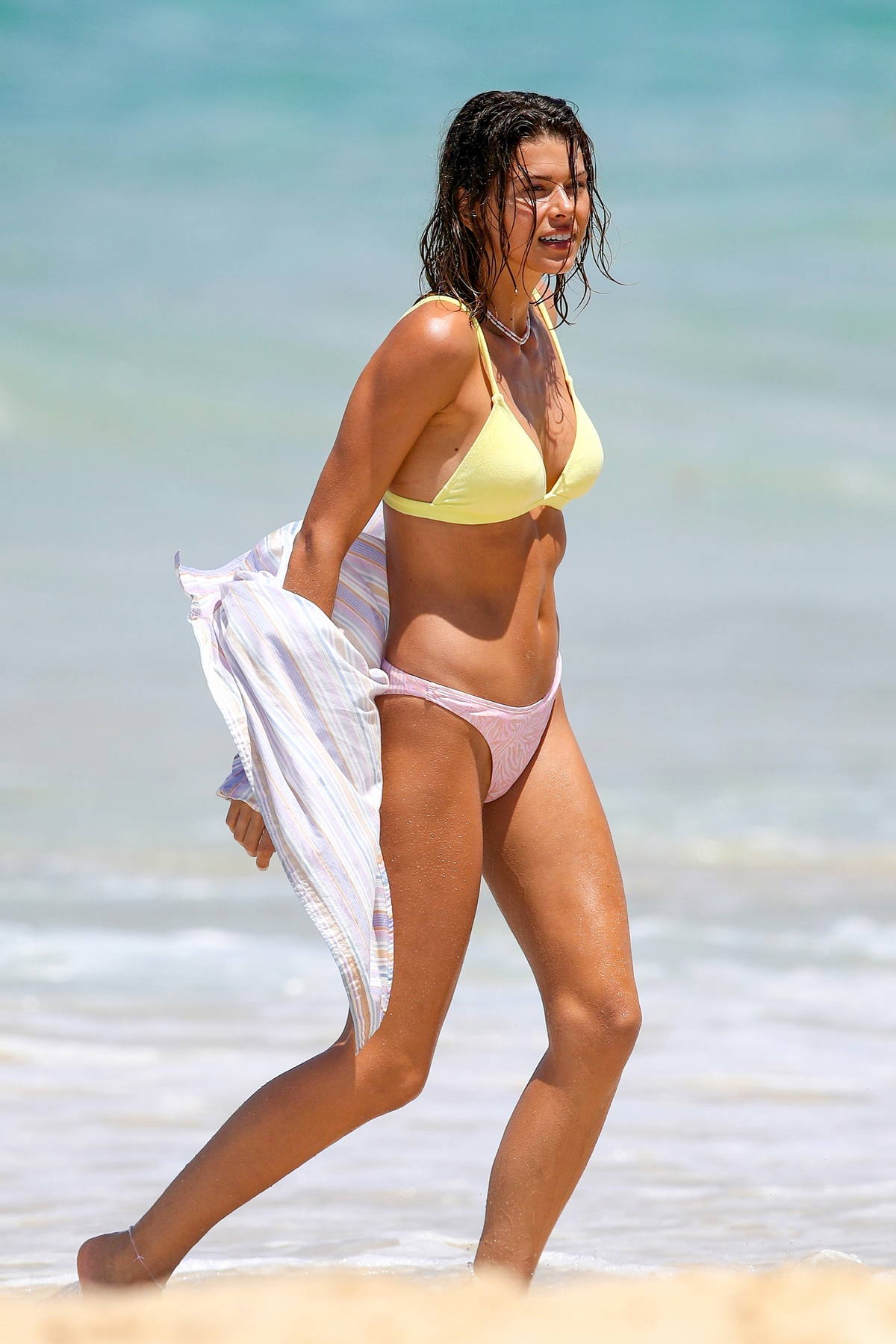 Georgia Fowler heats up the beach in yellow and pink bikini during a photoshoot at Bondi Beach, Sydney, Australia