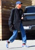 Hailey Bieber keeps it casual yet trendy in a Balenciaga blazer as she steps out in Santa Monica, California