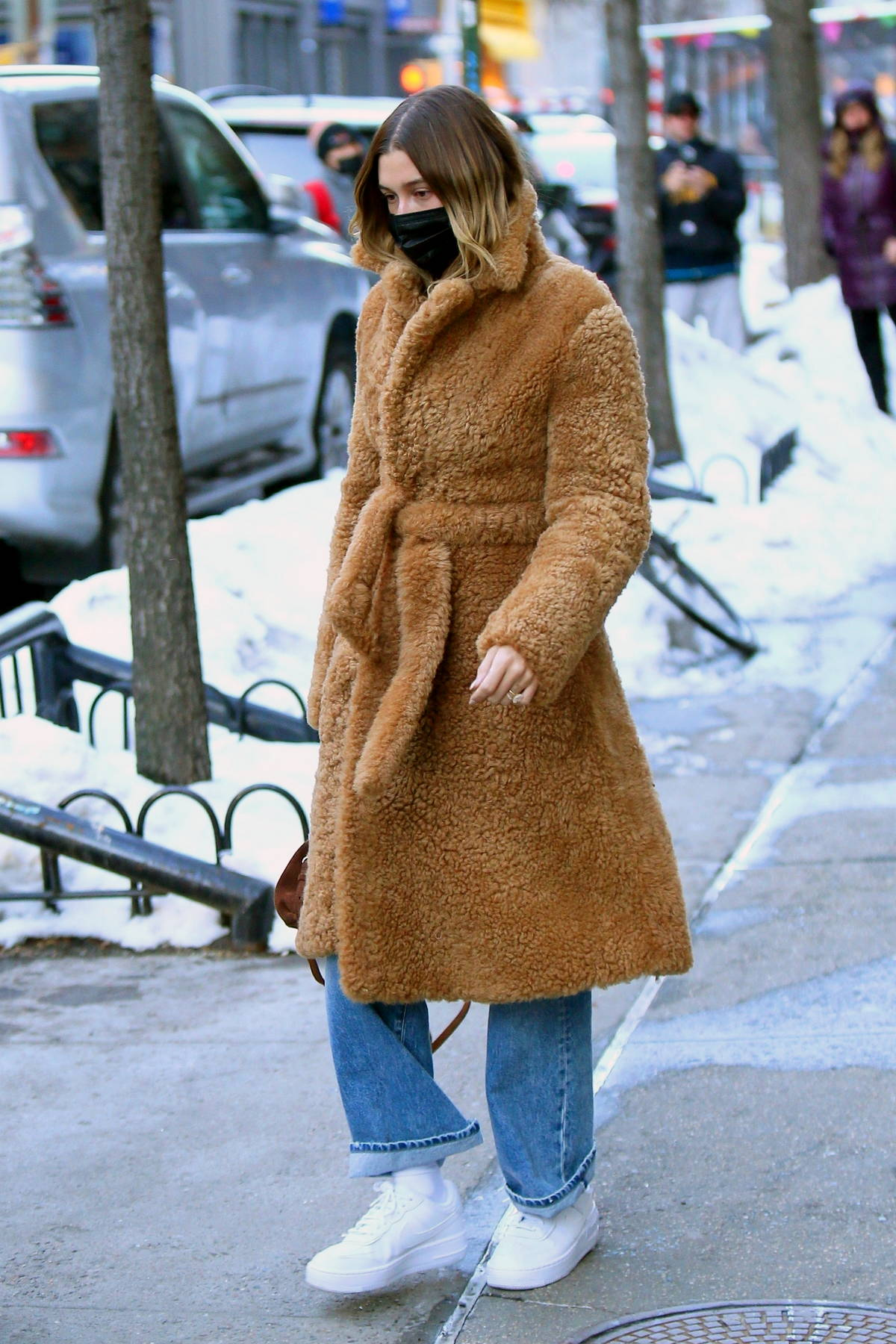 Hailey Bieber keeps warm in a brown faux fur coat while out in New York City