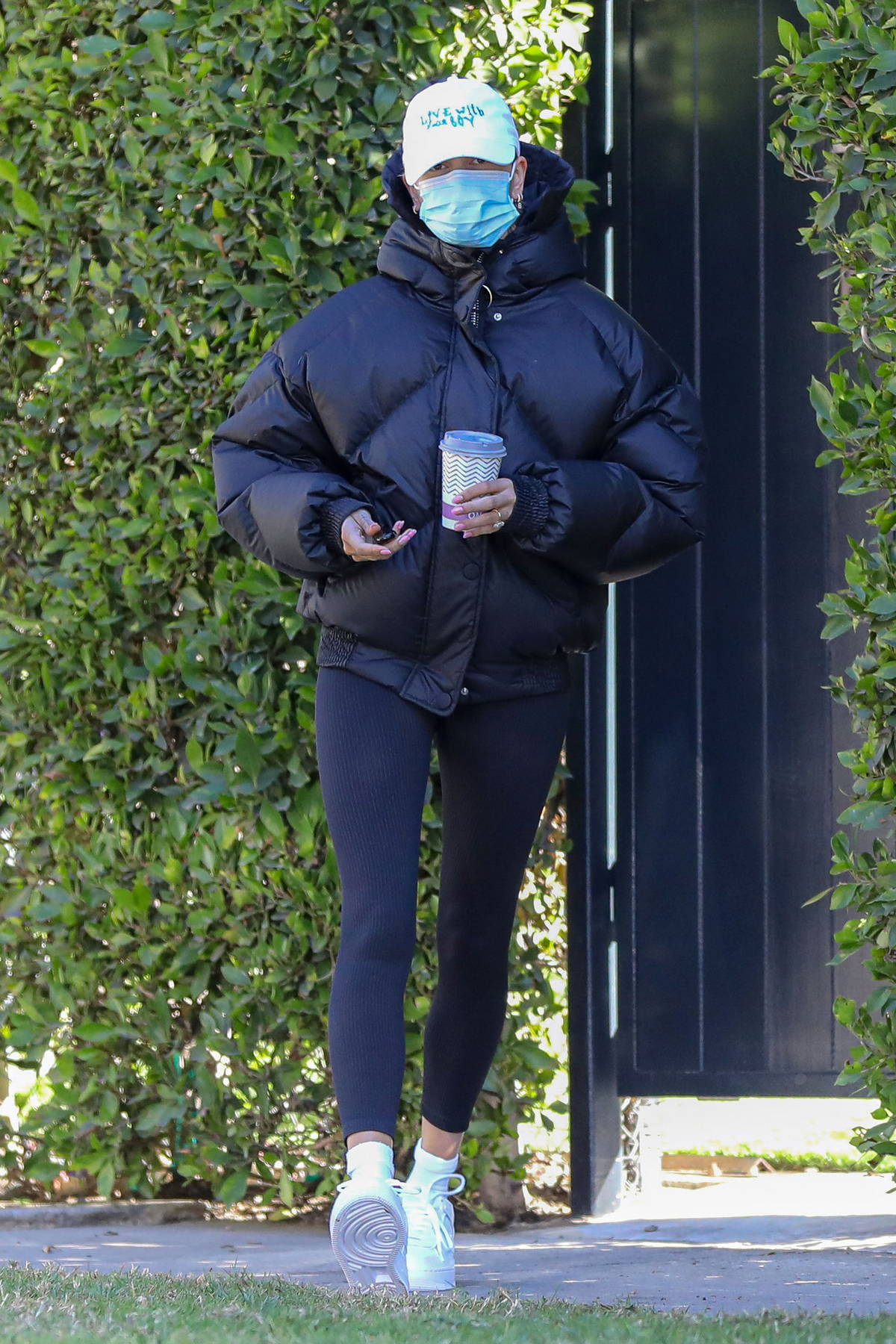 Hailey Bieber keeps warm in a puffer jacket as she leaves her morning pilates class in West Hollywood, California