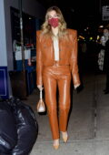 Hailey Bieber looks chic in a tan leather jacket with matching leather pants during a dinner outing in New York City