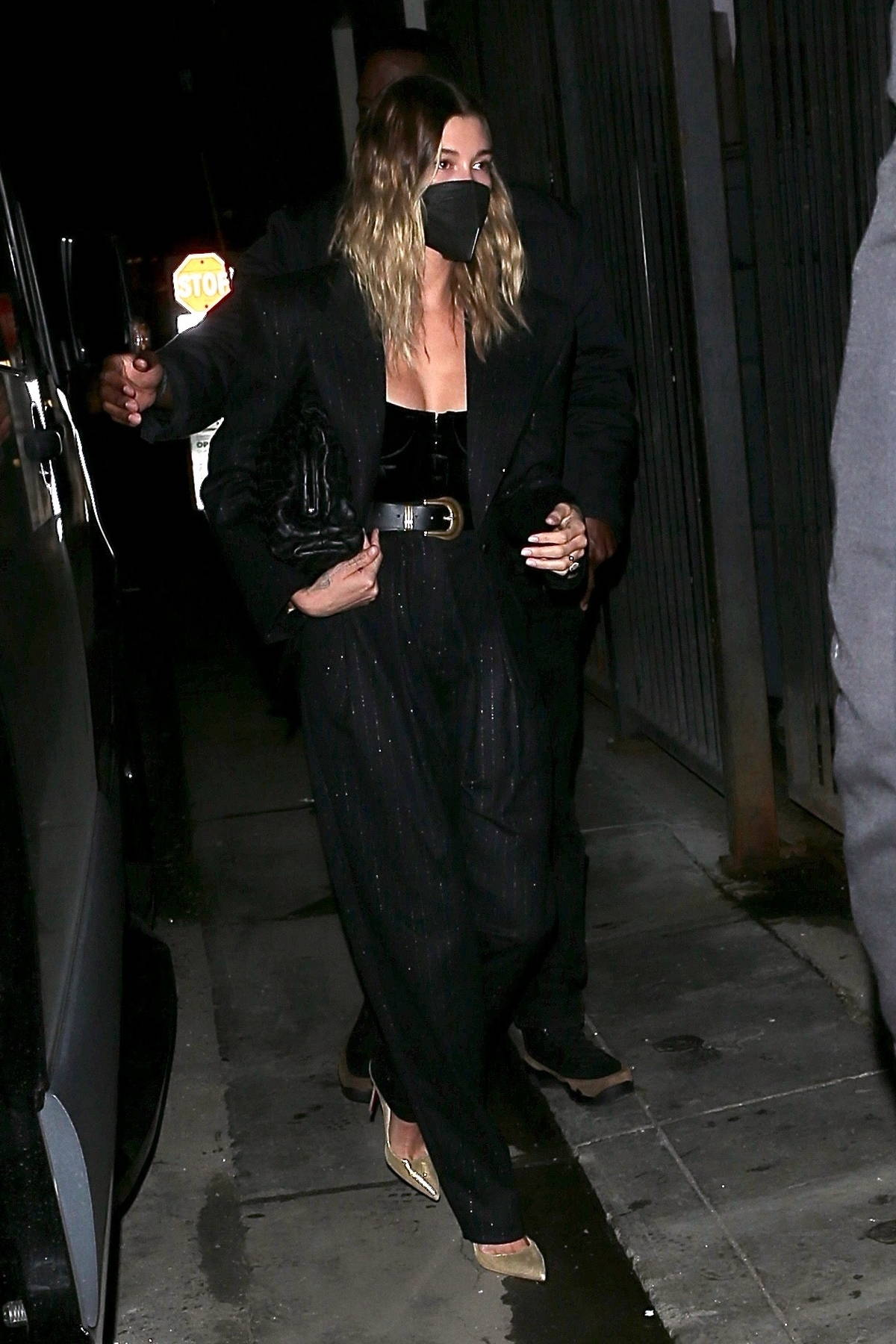 Hailey Bieber looks chic in black while stepping out for dinner at Catch in West Hollywood, California