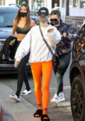 Hailey Bieber stands out in bright orange leggings while out for brunch with Addison Rae at Croft Alley in Beverly Hills, California