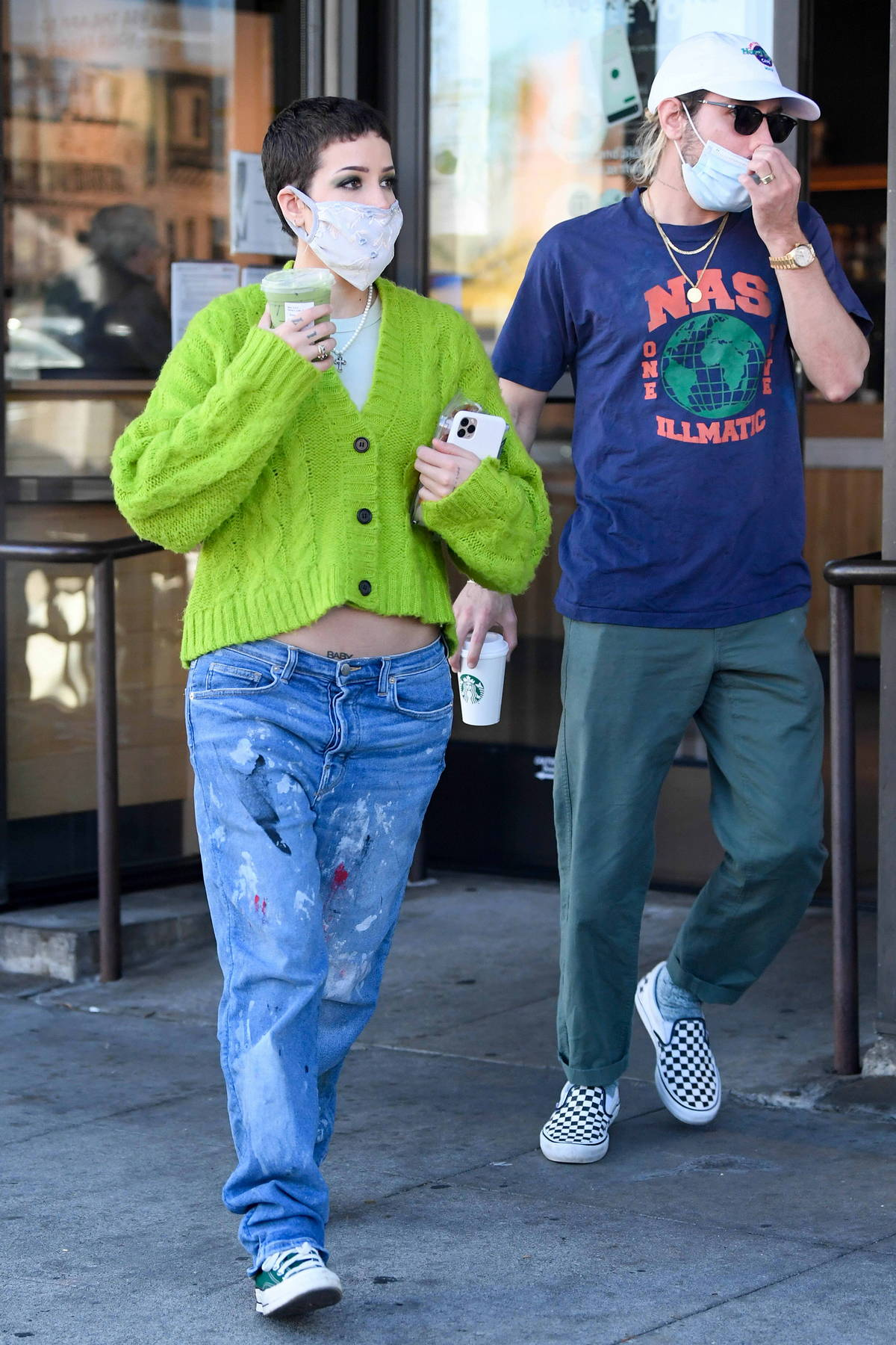 Halsey shows her baby bump in a green cardigan and low-rise jeans as she picks up Starbucks in Los Angeles