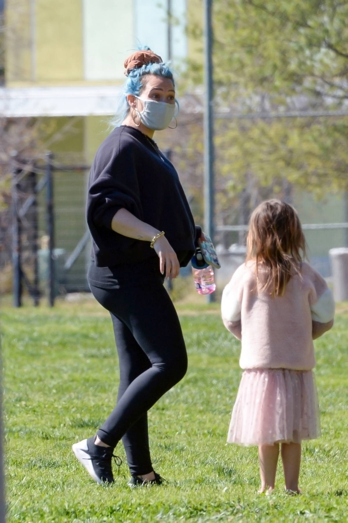 Hilary Duff enjoys some quality time with her family at a park in Los Angeles