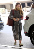 Hilary Duff looks great in a tie-dye dress as she touches down at LAX aiport in Los Angeles