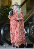 Hilary Duff stands out in electric blue hair and patterned red maxi dress while running errands in Los Angeles