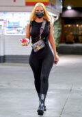 Iggy Azalea flaunts her curves in a black bodysuit while stopping for gas and some snacks in Beverly Hills, California