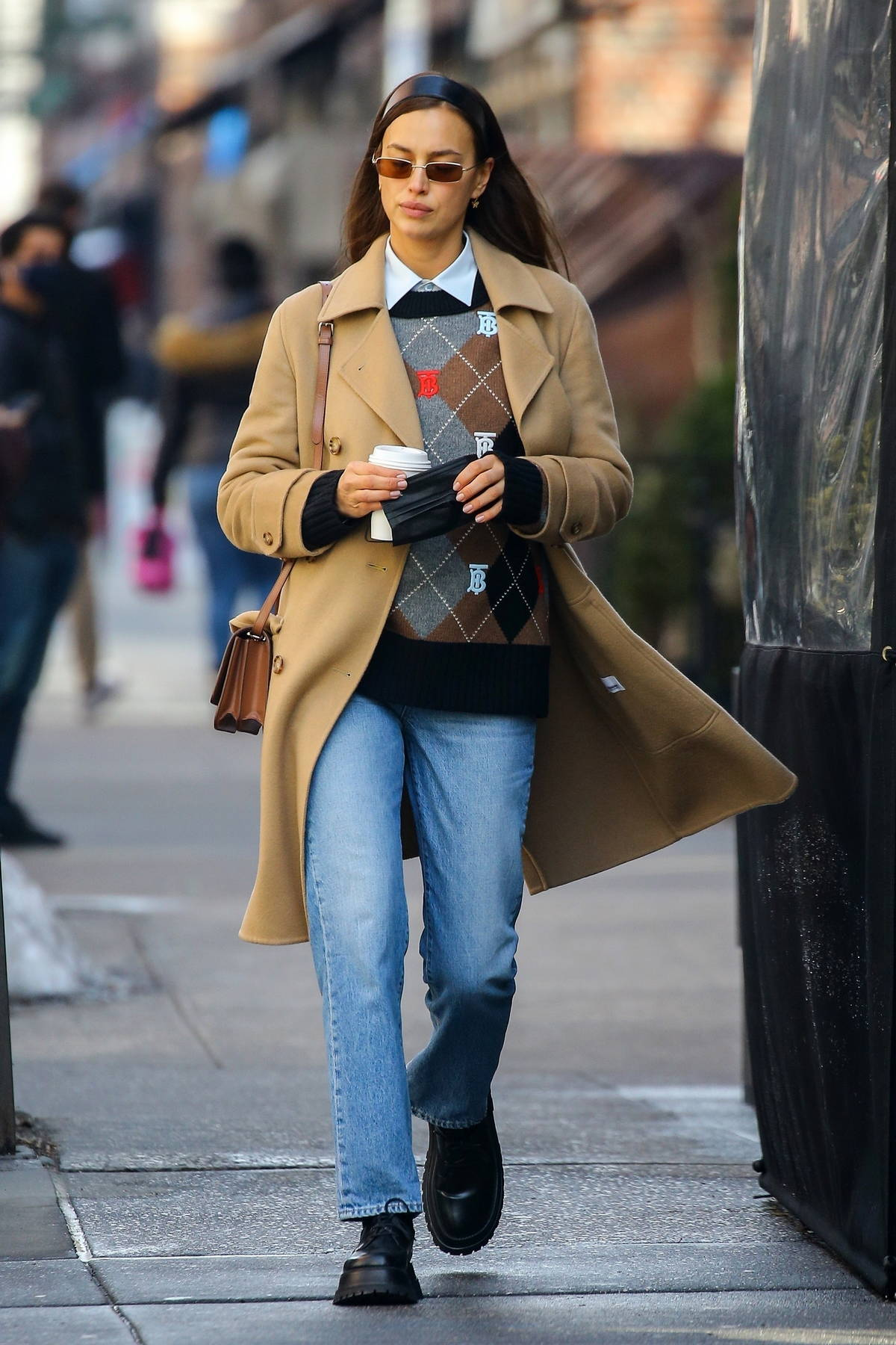 Irina Shayk looks stylish in a Burberry sweater with a beige coat while out running errands in New York City